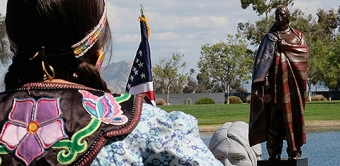 Photo of a native American dancer at the memorial site.