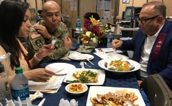 The judges evaluate the four-course meal creation by Purple Pig chef Aaron Anderson and California National Guard major Shannon Terry during the competition.