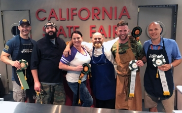 Local chefs Jon Clemons of The Porch, Aaron Anderson of Purple Pig Eats, and Bryce Palmer of Mulvaney's, and their veteran sous chefs display their ribbons.