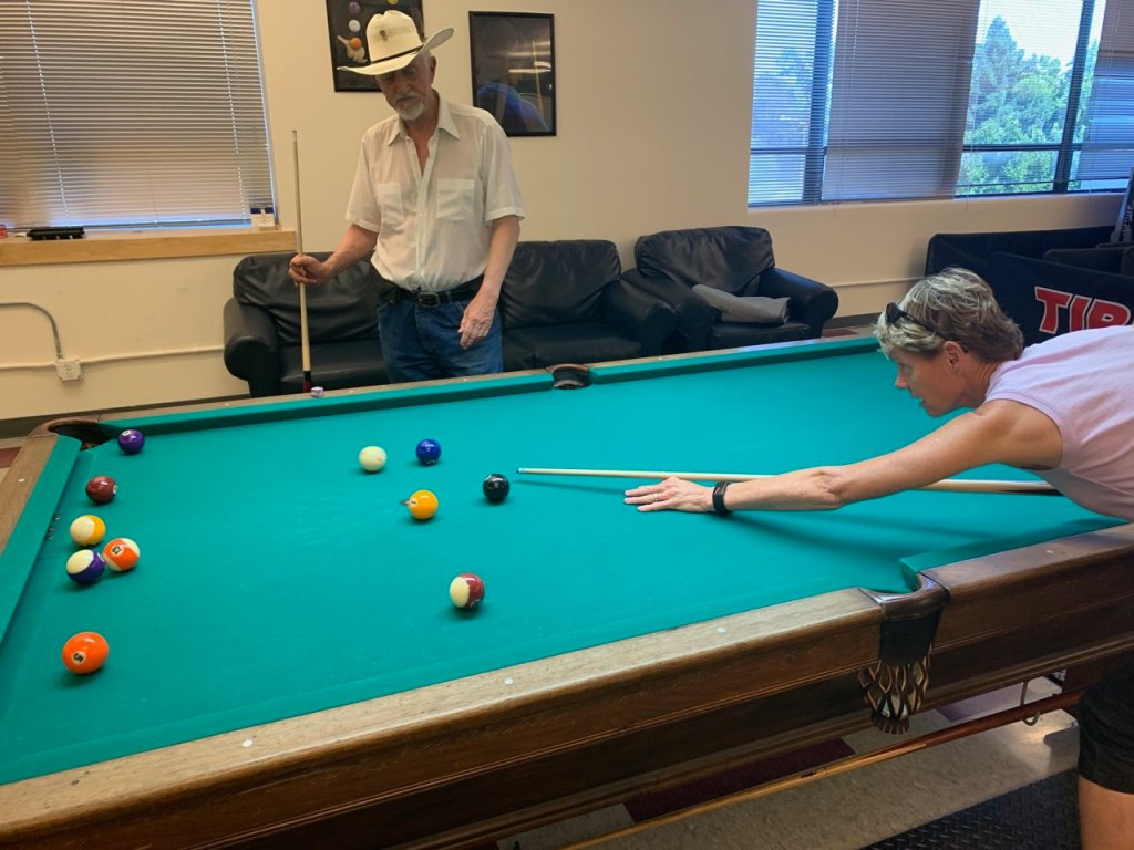 Lisa Peake, right, playing pool with a veteran resident.