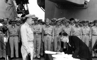 Japanese Foreign Minister Mamora Shigemitsu official signs documents of surrender ending World War II in 1945.