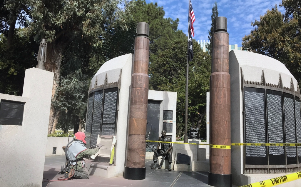 Engraver adds names to California Vietnam Memorial in Capitol Park.