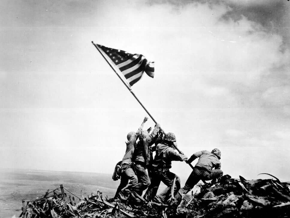 Pulitzer Prize-winning photo of Marines raising U.S. flag atop Mt. Suribachi on Iwo Jima, taken by Associated Press photographer Joe Rosenthal.