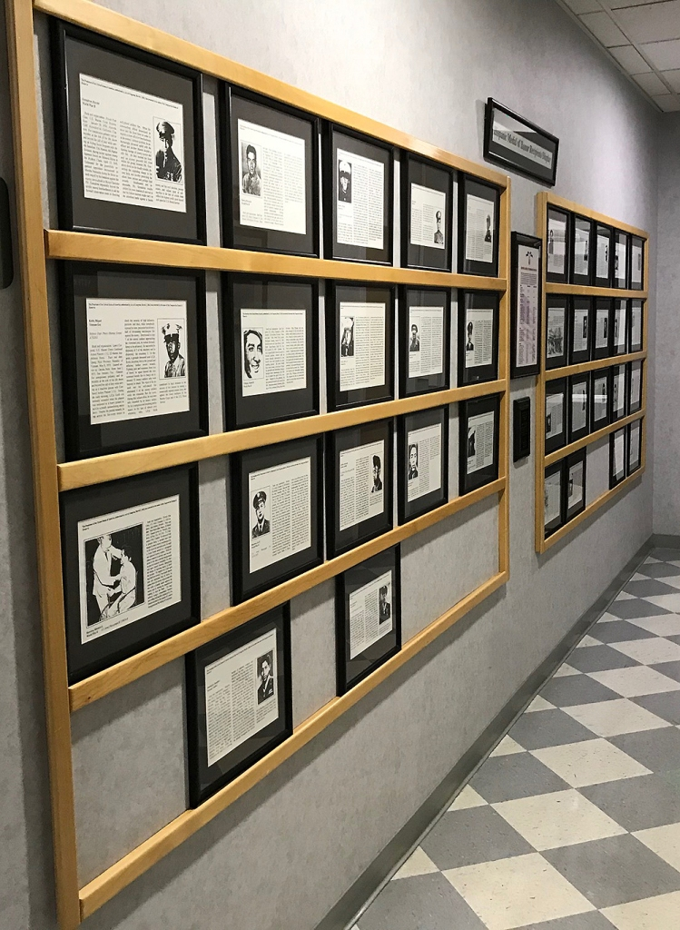 A photo of a hallway at CalVet which has photos of Hispanic Medal of Honor recipients.