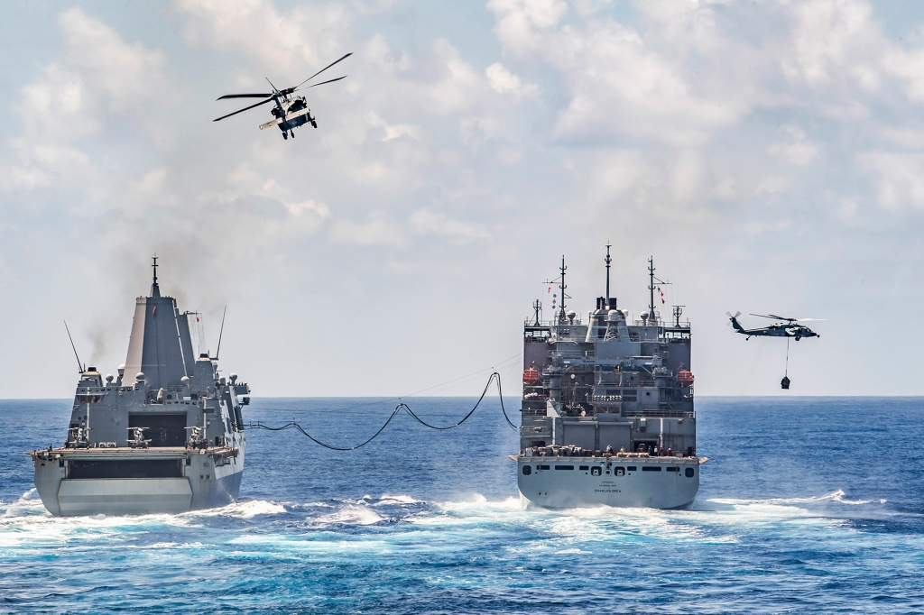 Photo of two ships in the middle of the Philippine Sea.
