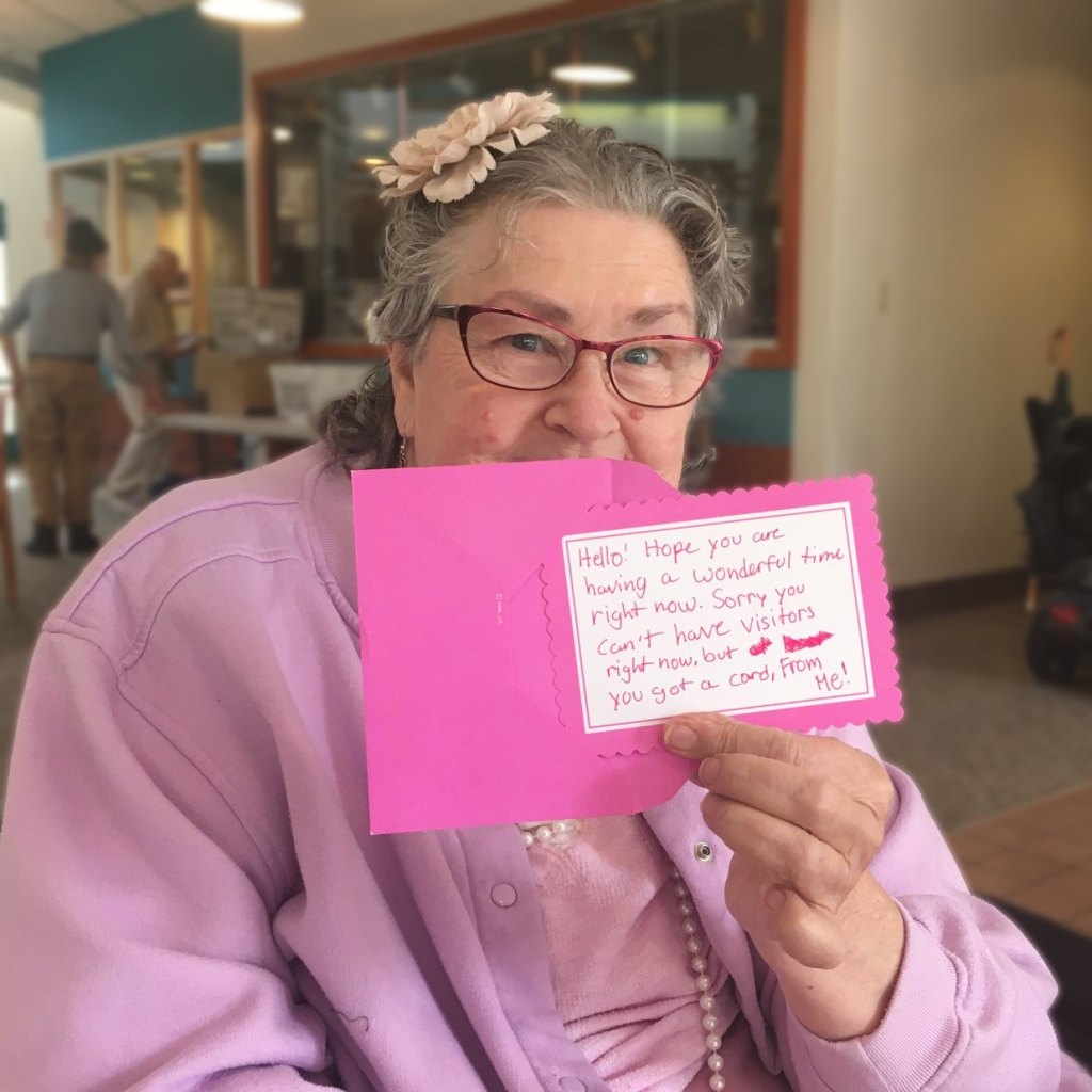 Resident of Chula Vista Home displays card of thanks from well-wisher.