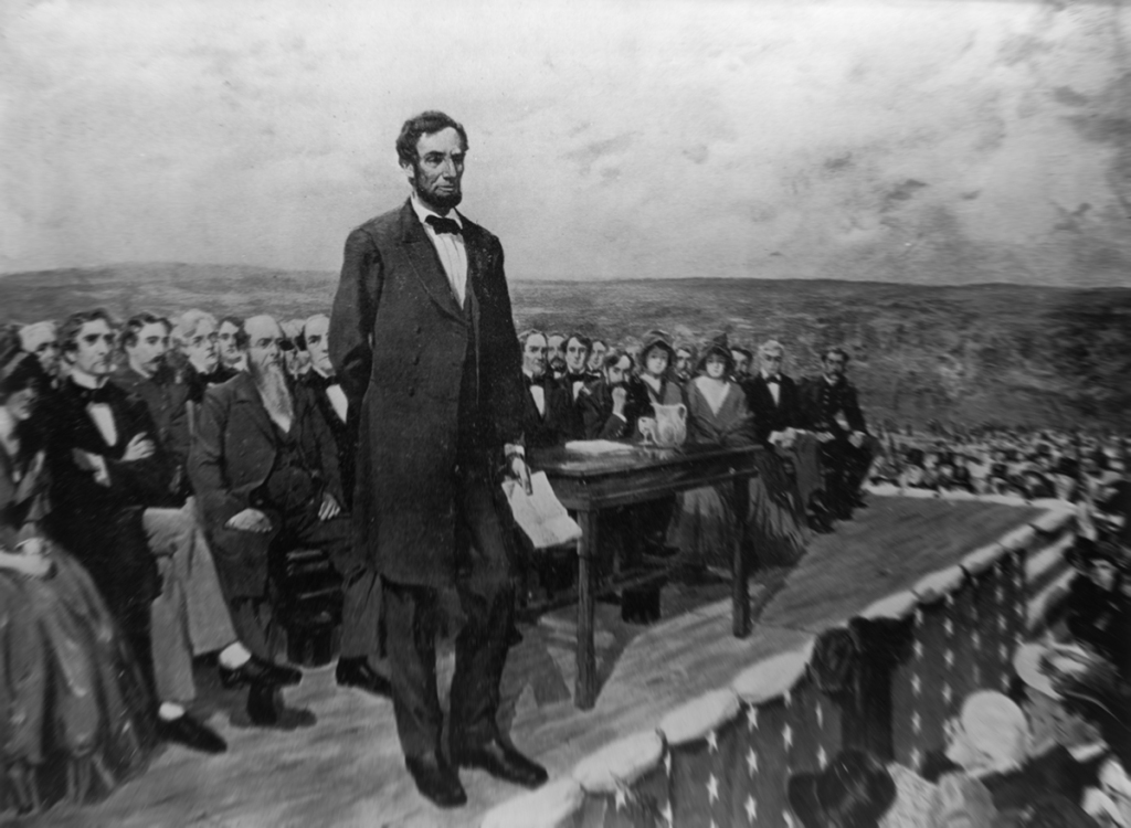 An illustration of Abraham Lincoln speaking in Gettysburg, Pennsylvania.