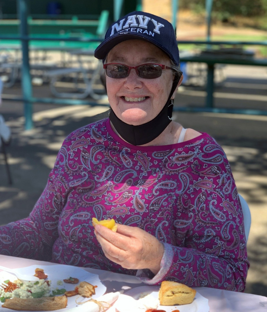 Veteran at Yountville enjoys a meal outdoors.