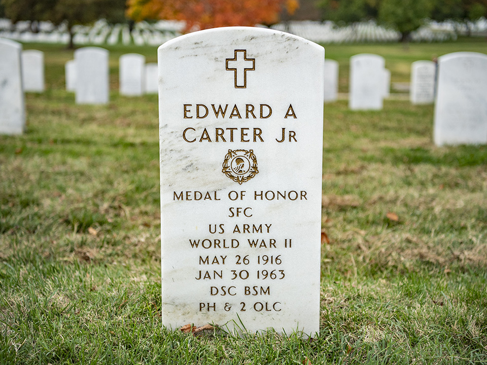 Photo showing Carter's Arlington National Cemetery headstone, engraved with Medal of Honor, his rank as Sgt. 1st Class.
