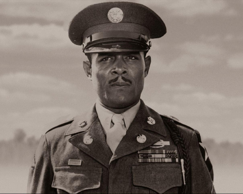 Sgt. Carter photographed in class A uniform with combat badge and medals.