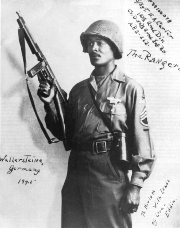 Staff Sgt. Carter posing with combat rifle in helmet and fatigues. WWII U.S.Army