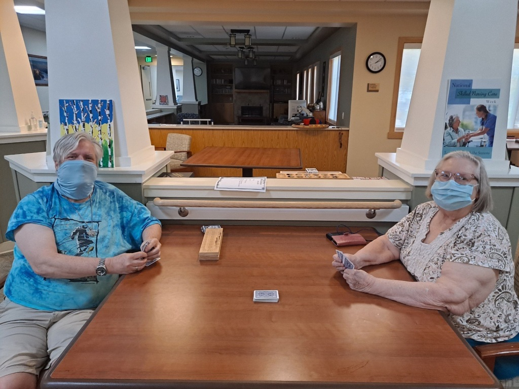 Residents at the Redding Home play cards as they visit for Mother's Day.