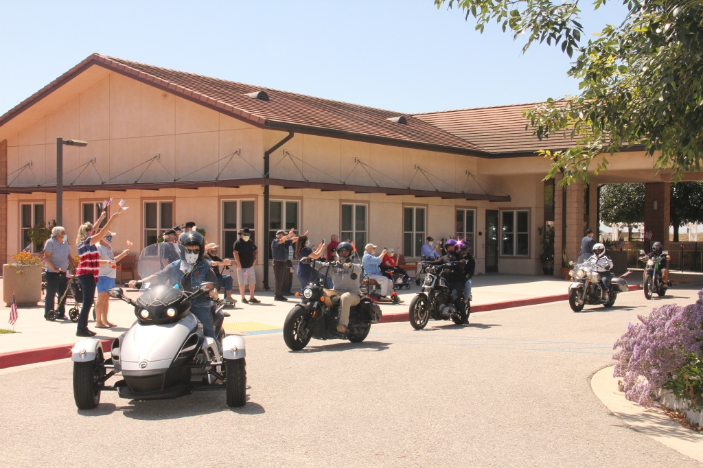 Residents of Ventura Veterans Home watch motorcyles ride by.