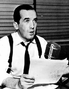 Murrow seated at broadcast microphone