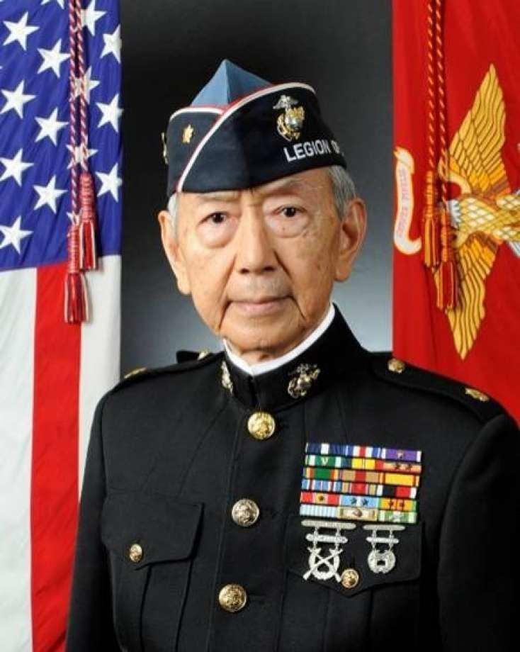 Formal portrait of retired major Kurt Lee in Marines dress blues and Legion of Valor cap.