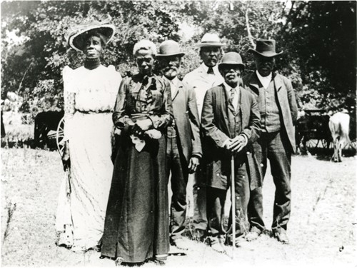 Photograph of six African Americans who've learned they are slaves no more.