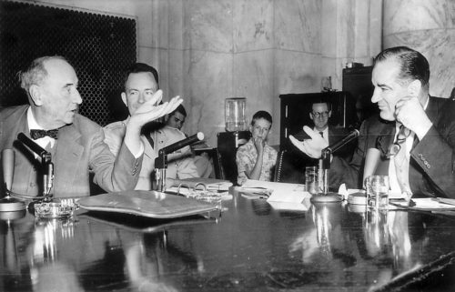 Welch and McCarthy sit at same table during the televised hearings of McCarthy vs Army. Welch represents the Army.