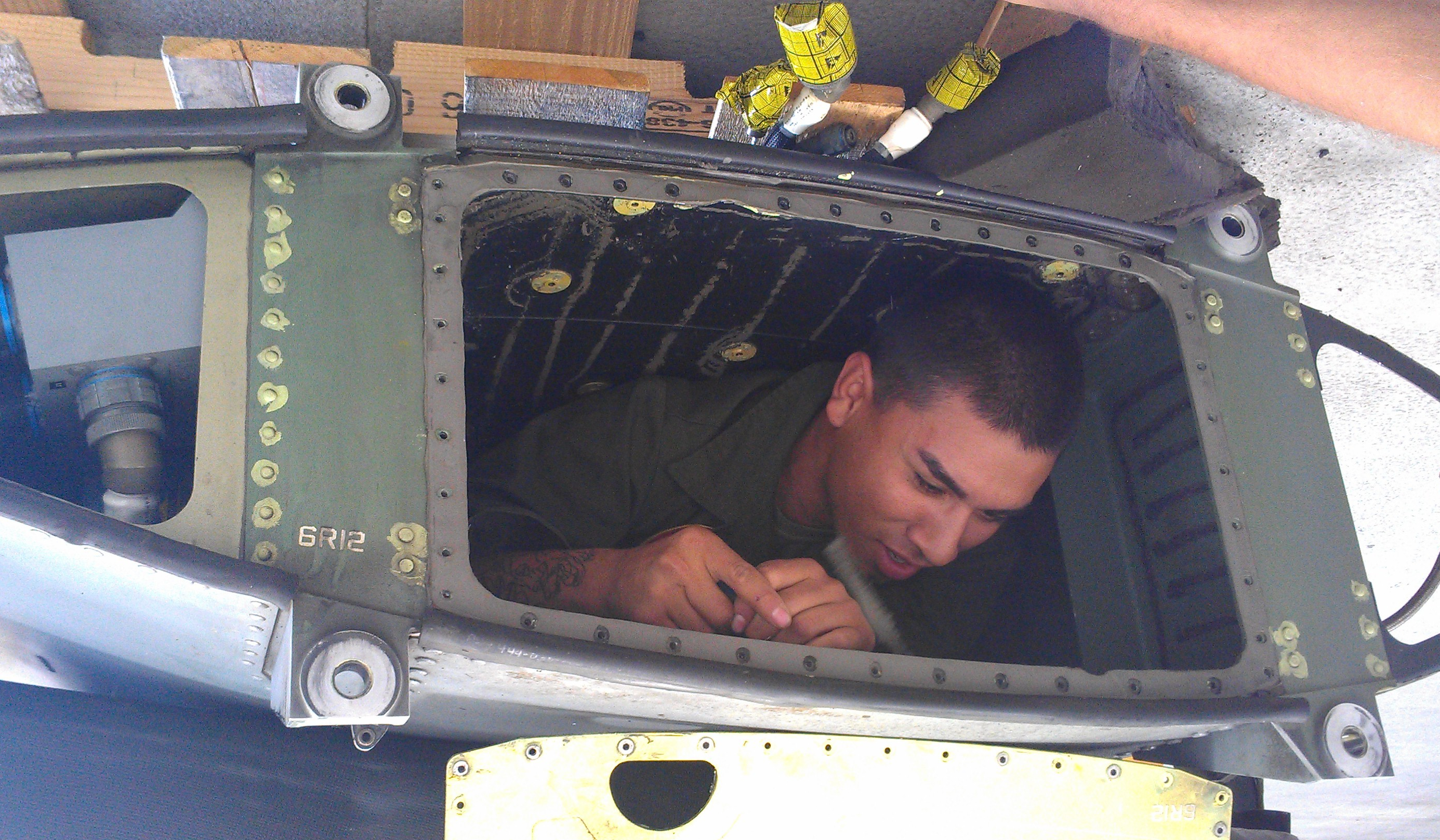 Jesus working maintenance on helicopter.
