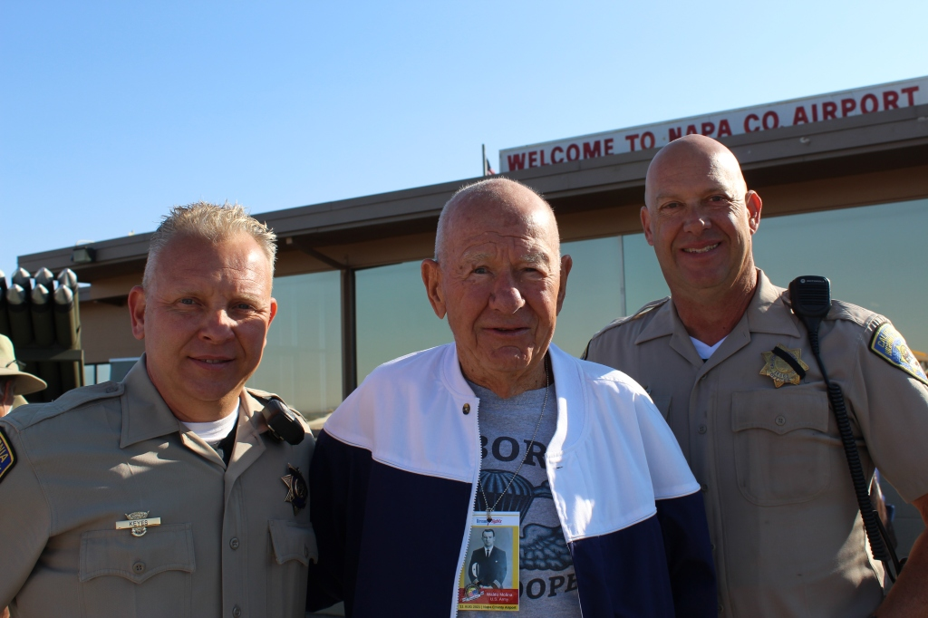 U.S. Army Air Force veteran Waldo Molina with a few guys from the CHP escort.
