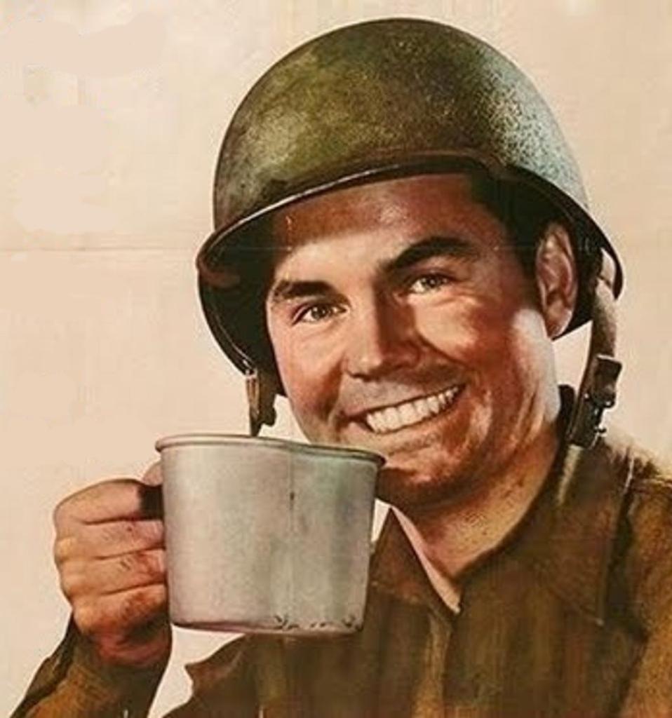 1950s style Army man wearing a helmet lifts coffee mug.