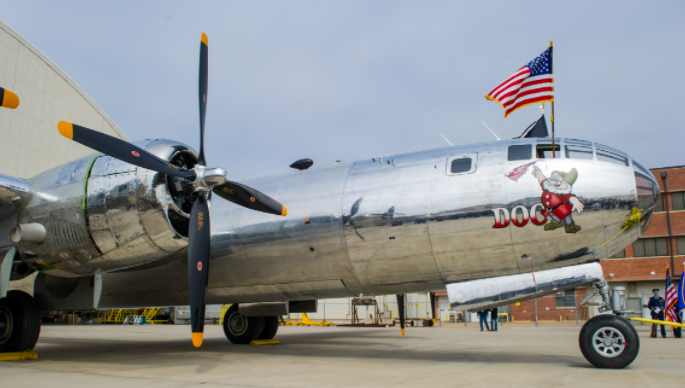 The restored B-29 on display on a tarmac.
