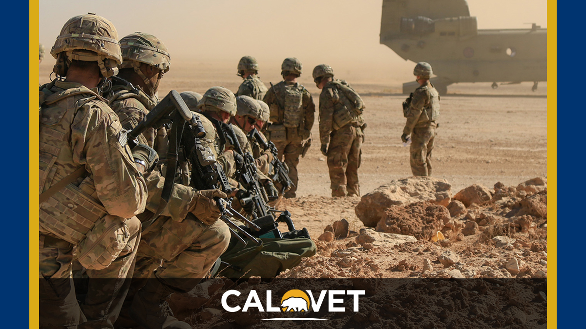 Soldiers assigned to the 1st Squadron, 3rd Cavalry Regiment, await extraction via a CH-47 Chinook, Al Asad Air Base, Iraq.