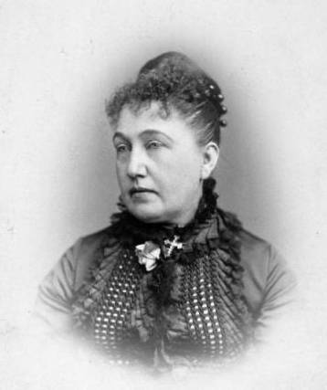 A black and white photograph of Mary Helen Crosby dressed in all black taken sometime around 1880s.
